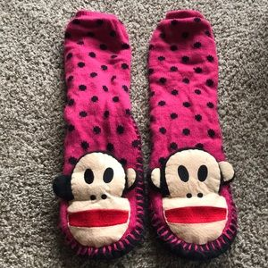 Slipper socks with sock monkeys on the foot.